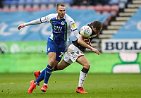Bolton Wanderers' Callum Connolly competing with Wigan Athletic's Nick Powell <br /> <br /> Photographer Andrew Kearns/CameraSport<br /> <br /> The EFL Sky Bet Championship - Wigan Athletic v Bolton Wanderers - Saturday 16th March 2019 - DW Stadium - Wigan<br /> <br /> World Copyright &copy; 2019 CameraSport. All rights reserved. 43 Linden Ave. Countesthorpe. Leicester. England. LE8 5PG - Tel: +44 (0) 116 277 4147 - admin@camerasport.com - www.camerasport.com