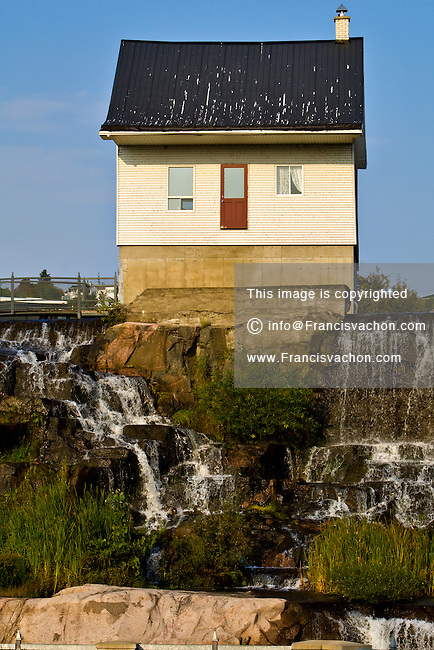 The ?petite maison blanche? (small white house) is pictured in the Saguenay borough of Chicoutimi September 24, 2008. The small white house became the symbol of the 1996 Saguenay Flood (Deluge du Saguenay) when it stood unharmed while torrents of water flowed around during the biggest overland flood in 20th-century Canadian history.