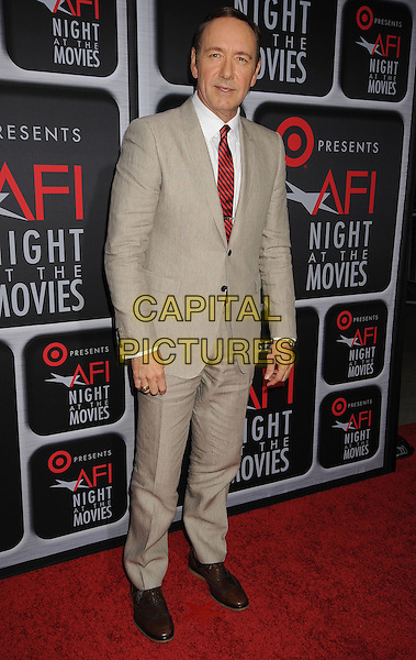 Kevin Spacey.Target presents AFI's Night at the Movies at ArcLight Cinemas in Hollywood, CA., USA..April 24th, 2013.full length beige suit white shirt red tie.CAP/ADM/BT.©Birdie Thompson/AdMedia/Capital Pictures
