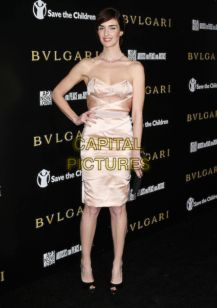 PAZ VEGA .Bvlgari Fundraiser Benefiting Save The Children's U.S. Programs And Artists For Peace And Justice, held at a private residence, Beverly Hills, California, USA, .13th January 2011..full length strapless peach dress hand on hip peep toe clutch bag cream black slingbacks shoes bustier .CAP/ADM/KB.©Kevan Brooks/AdMedia/Capital Pictures.