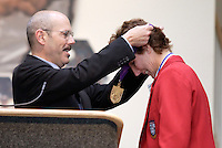 2004 Hall of Fame inductee Michelle Akers is presented with her medal by the National Soccer Hall of Fame President Will Lunn on Monday October 11, 2004 at the National Soccer Hall of Fame and Museum, Oneonta, NY..