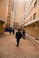 New construction has begun appearing in the Old Town section of Kashgar, Xinjiang, China.  Government plans will level most of the Old Town and replace traditional housing and alleyways with modern high-rise apartment buildings.