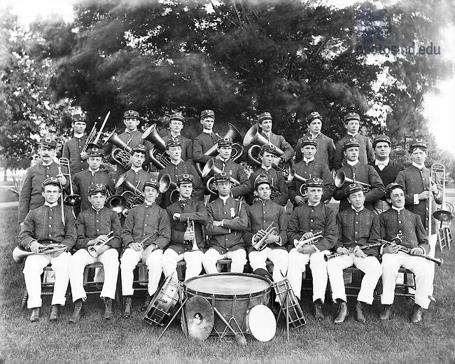 GGPN 15/07:  Notre Dame Marching Band, Jubilee Year, 1895..Standing  Back Row: Unidentified, Joseph Davilla, Jesse Langtry, William C. Kegler, Jose San Romain, Lucian C. Wheeler, Thomas Finnerty.Standing Middle Row: James Kivlin, Charles Piquette, Frank Smith, Elmer Murphy, Francis Barton, Charles McPhee, Unidentified, Edward Hay, Jacob Rosenthal, Thomas H. O'Brien .Seated:  Francis Cornell, Unidentified, Edward Rauch, Joseph Marmon, Professor Newton Preston, James V. O'Brien, Thomas A. Steiner, Frank Harrison, John Forbing.Image from the University of Notre Dame Archives.