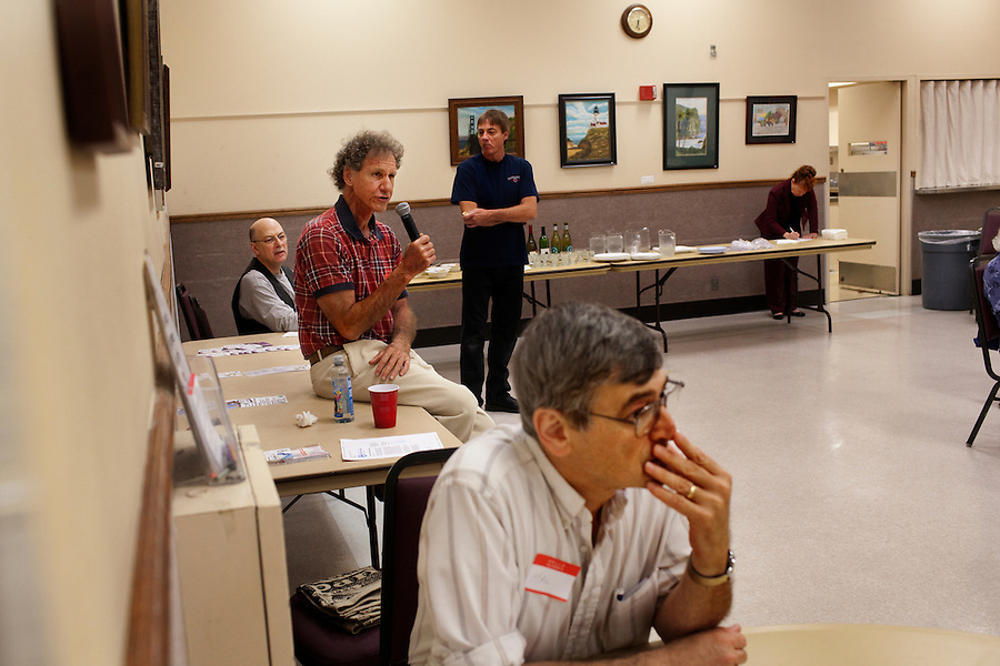 Laguna Woods, California, November 3, 2010 - Bill Roley (with microphone) asks a question during a meeting of Village Cannabis during one of their monthly meetings. Village Cannabis Club is a sister organization to Laguna Woods Village for Medical Cannabis, a collective of about 100 members that operates as a dispensary for medical marijuana in the nearby senior community of Laguna Woods Village and its environs. The club serves as a organization that holds regular meetings to help educate the community to the benefits of marijuana. Tonight they discussed the outcome of Proposition 19, which would have made recreational marijuana use legal. .