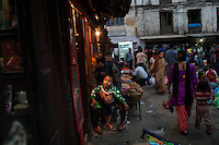 A man and child in front of a shop on the streets of Durban square in Kathmandu. 30 April 2013, © Nicolas Axelrod 2013