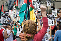 Aid flotilla activists are killed by Israeli special forces some 60 kilometres off the Israel coastline.   Toronto activists protest the killings in a demonstration and march from Israel's embassy past Queen's Park to Dundas Square in downtown Toronto Canada