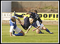23/08/2003                   Copyright Pic : James Stewart.File Name : stewart-falkirk v qots 02.COLIN MCMENAMIN IS PULLED DOWN IN THE BOX BY JAMES THOMSON......James Stewart Photo Agency, 19 Carronlea Drive, Falkirk. FK2 8DN      Vat Reg No. 607 6932 25.Office     : +44 (0)1324 570906     .Mobile  : +44 (0)7721 416997.Fax         :  +44 (0)1324 570906.E-mail  :  jim@jspa.co.uk.If you require further information then contact Jim Stewart on any of the numbers above.........