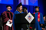 Deliana Andrea Escobari Ocampo, student speaker, offers her fellow graduates names to the alumni association along with David Miller, dean of DePaul University College of Computing and Digital Media, Salma Ghanem, dean of the College of Communication, and Sanjay Gidwani, Class of 2003 Sunday, June 11, 2017, during the DePaul University College of Computing and Digital Media and the College of Communication commencement ceremony at the Allstate Arena in Rosemont, IL. (DePaul University/Jamie Moncrief)
