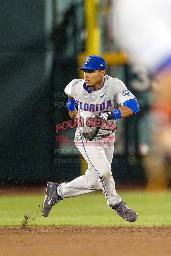 Florida Gators shortstop Richie Martin (12) on defense during the NCAA College baseball World Series against the Virginia Cavaliers on June 15, 2015 at TD Ameritrade Park in Omaha, Nebraska. Virginia defeated Florida 1-0. (Andrew Woolley/Four Seam Images)