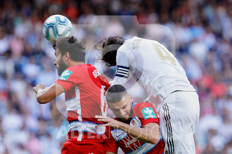 Sergio Ramos of Real Madrid and German Sanchez of Granada CF during La Liga match between Real Madrid and Granada CF at Santiago Bernabeu Stadium in Madrid, Spain. October 05, 2019. (ALTERPHOTOS/A. Perez Meca)