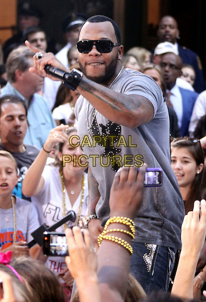 "FLO RIDER.Performs On NBC's ""Today"" Show at Rockefeller Center, New York, NY, USA, .14th August 2009..half length music concert gig live microphone grey gray t-shirt silver necklace tattoo sunglasses flo rida Tramar Dillard .CAP/ADM/AC.©Alex Cole/AdMedia/Capital Pictures"