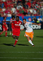 01 July 2010:  Houston Dynamo midfielder Brian Mullan #9 and Toronto FC defender Nana Attakora #3 in action during a game between the Houston Dynamo and the Toronto FC at BMO Field in Toronto..Final score was 1-1....
