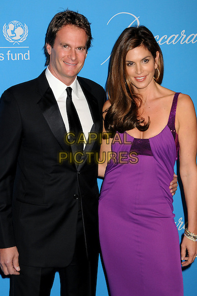 RANDE GERBER & CINDY CRAWFORD.UNICEF Ball 2009 Honoring Jerry Weintraub held at the Beverly Wilshire Hotel, Beverly Hills, California, USA..December 10th, 2009.half length dress black suit married husband wife gold hoop earrings  purple sequins sequined .CAP/ADM/BP.©Byron Purvis/AdMedia/Capital Pictures.