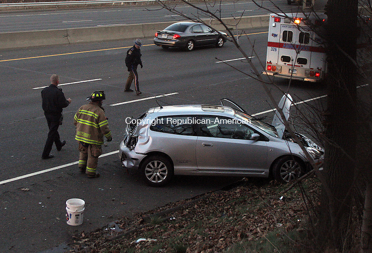WATERBURY, CT - 22 NOVEMBER 2008 112208JW05.jpg -- State police and Waterbury fire crews work on a accident in which a Honda Civic rolled over on the Route 73 and Route 8 merge early Saturday evening. Jonathan Wilcox Republican-American