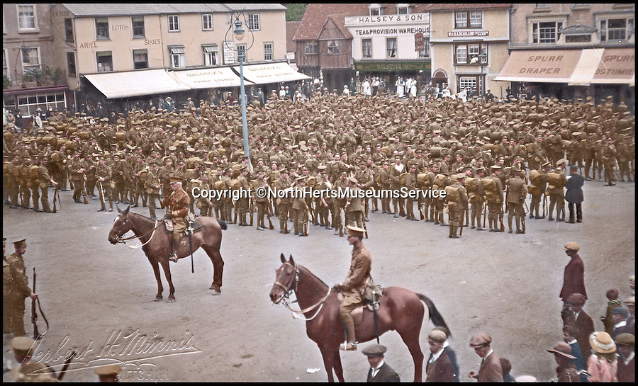 BNPS.co.uk (01202 558833)<br /> Pic: NorthHertsMuseumsService/BNPs<br /> <br /> ***Please Use Full Byline***<br /> <br /> Hitchin Square: A battalion of the Wawrickshire Regiment parading in Hitchin market square on the wayto war in August 1914. <br /> <br /> Black and white photos of British Tommies preparing for the First World War have been brought to life after they were digitally colourised to mark the 100th anniversary of the start of the conflict.<br /> <br /> Some of the snaps show soldiers in vivid colour getting battle-ready at training camps in the Home Counties in July 1914.<br /> <br /> Others depict the men dressed in their smart green uniforms on parade in a market square on the eve of war and then stood on a train station platform as they head off for France.<br />  <br /> As well as being filled with colour, some of the photos are tinged with poignancy as many of the men pictured never came back.