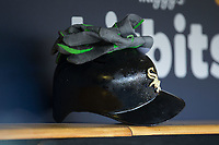 A pair of batting gloves sit on top of a Chicago White Sox batting helmet during the game against the Detroit Tigers at Comerica Park on June 2, 2017 in Detroit, Michigan.  The Tigers defeated the White Sox 15-5.  (Brian Westerholt/Four Seam Images)