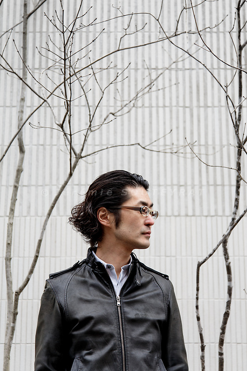 Tokyo, February 24 2014 - Portrait of Japanese architect Makoto Yamaguchi in front of oggi, a residence he designed in the Otsuka area.