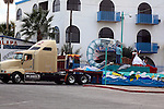 TRUCK PULLS FLOAT WITH GIANT SHRIMP AND BEAUTY QUEENS IN CARNIVAL PARADE