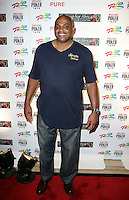 CHARLES BARKLEY .The Ante Up for Africa Celebrity Poker Tournament at the Rio Resort Hotel and Casino, Las Vegas, Nevada, USA..July 2nd, 2009.full length jeans denim blue top .CAP/ADM/MJT.© MJT/AdMedia/Capital Pictures