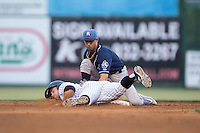 Carlos Herrera (4) of the Asheville Tourists fields a throw as Tyler Sullivan (5) of the Kannapolis Intimidators dives back into second base at Intimidators Stadium on May 28, 2016 in Kannapolis, North Carolina.  The Intimidators defeated the Tourists 5-4 in 10 innings.  (Brian Westerholt/Four Seam Images)