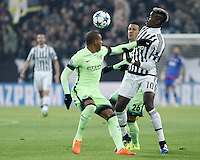 Calcio, Champions League: Gruppo D - Juventus vs Manchester City. Torino, Juventus Stadium, 25 novembre 2015. <br /> Juventus&rsquo; Paul Pogba, right, is challenged by Manchester City's Fernando, left, and Mart&iacute;n Demichelis, during the Group D Champions League football match between Juventus and Manchester City at Turin's Juventus Stadium, 25 November 2015. <br /> UPDATE IMAGES PRESS/Isabella Bonotto