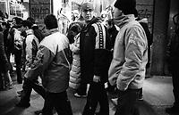 Milano, sabato pomeriggio. ragazzi a passeggio lungo le vetrine dei negozi alla moda di via Torino, in centro città --- Milan, saturday afternoon. youngsters walking along the fashion stores of Torino street, in downtown