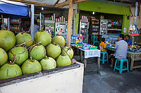 Jimbaran, Bali, Indonesia.  Fresh Coconuts outside a Small Restaurant--to be Sold as a Refreshing Drink.
