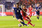 Sakai Hiroki of Japan (L) fights for the ball with Nguyen Phong Hong Duy of Vietnam (R) during the AFC Asian Cup UAE 2019 Quarter Finals match between Vietnam (VIE) and Japan (JPN) at Al Maktoum Stadium on 24 January 2019 in Dubai, United Arab Emirates. Photo by Marcio Rodrigo Machado / Power Sport Images