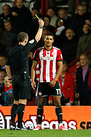 Ollie Watkins of Brentford is booked by referee, Stuart Attwell during the Sky Bet Championship match between Brentford and Leeds United at Griffin Park, London, England on 4 November 2017. Photo by Carlton Myrie.