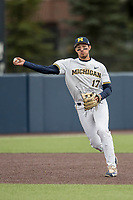 Michigan Wolverines third baseman Drew Lugbauer (17) makes a throw to first base against the Indiana Hoosiers during the NCAA baseball game on April 21, 2017 at Ray Fisher Stadium in Ann Arbor, Michigan. Indiana defeated Michigan 1-0. (Andrew Woolley/Four Seam Images)