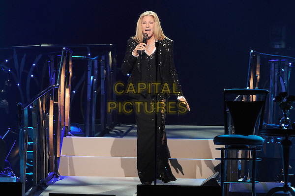 Barbara Streisand <br /> plays live at the O2 Arena in London.<br /> 1st June 2013.<br /> music concert on stage live gig full length black microphone singing lace sparkly jacket sequined sequin lace long maxi skirt sheer <br /> CAP/BEL<br /> &copy;Tom Belcher/Capital Pictures