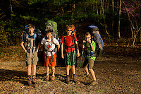 Troop 10 Boy Scouts hike to their campsites during a spring backpacking in the South Mountains State Park in Connelly Springs, North Carolina.