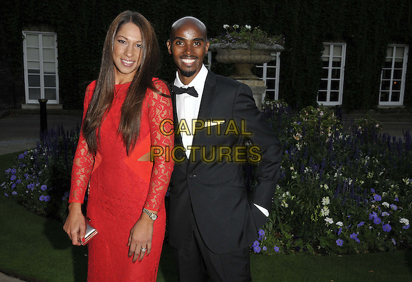 LONDON, ENGLAND - AUGUST 28: Tania Farah ( nee Nell ) &amp; Mo Farah attend the Mo Farah Foundation &quot;A Night Of Champions&quot; Dinner, The Hurlingham Club, Ranelagh Gardens, on Thursday August 28, 2014 in London, England, UK. <br /> CAP/CAN<br /> &copy;Can Nguyen/Capital Pictures
