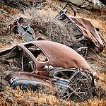 Junked cars used for riffraff stream side erosion control, Diablo Range, Calif.