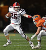 Hugh Kelleher #25 of MacArthur rushes for a gain during the Nassau County football Conference II semifinals against Carey at Shuart Stadium, located on the campus of Hofstra University in Hempstead, on Thursday, Nov. 8, 2018.