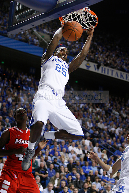 Marquis Teague dunks the ball in the game against  Marist College, at Rupp Arena, in Lexington, Ky., on Friday, Nov. 11, 2011. Teague scored 16 points in 27 minutes of play. Photo by Latara Appleby | Staff ..