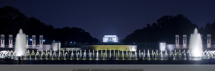 The fountains of the National World War II Memorial in Washington, DC are encircled by large granite pillars engraved with the names of the states.  Here, the Lincoln Memorial is visible in the distance.