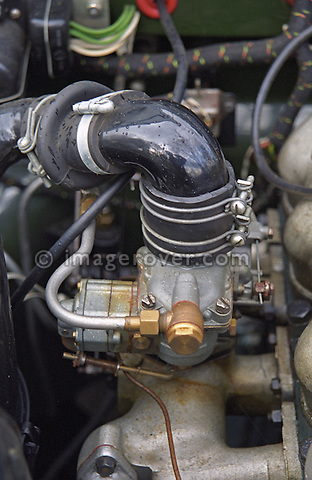 Solex carburettor of a perfectly restored and award winning 1953 2.0 litre petrol Land Rover Series One 80 inch. --- No releases available. Automotive trademarks are the property of the trademark holder, authorization may be needed for some uses.