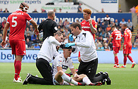 Swansea City's Jay Fulton receives treatment after a clash of heads with Nottingham Forest's Jack Robinson (Not in frame)<br /> <br /> Photographer Ian Cook/CameraSport<br /> <br /> The EFL Sky Bet Championship - Swansea City v Nottingham Forest - Saturday 15th September 2018 - Liberty Stadium - Swansea<br /> <br /> World Copyright &copy; 2018 CameraSport. All rights reserved. 43 Linden Ave. Countesthorpe. Leicester. England. LE8 5PG - Tel: +44 (0) 116 277 4147 - admin@camerasport.com - www.camerasport.com