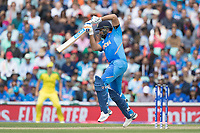 Rohit Sharma (India) pushes into the covers during India vs Australia, ICC World Cup Cricket at The Oval on 9th June 2019