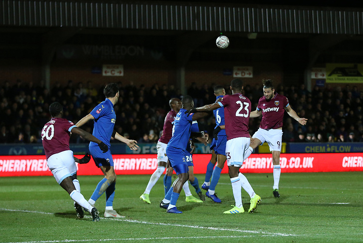 West Ham United's Andy Carroll with a header towards goal<br /> <br /> Photographer Rob Newell/CameraSport<br /> <br /> Emirates FA Cup Fourth Round - AFC Wimbledon v West Ham United - Saturday 26th January 2019 - Kingsmeadow Stadium - London<br />  <br /> World Copyright © 2019 CameraSport. All rights reserved. 43 Linden Ave. Countesthorpe. Leicester. England. LE8 5PG - Tel: +44 (0) 116 277 4147 - admin@camerasport.com - www.camerasport.com
