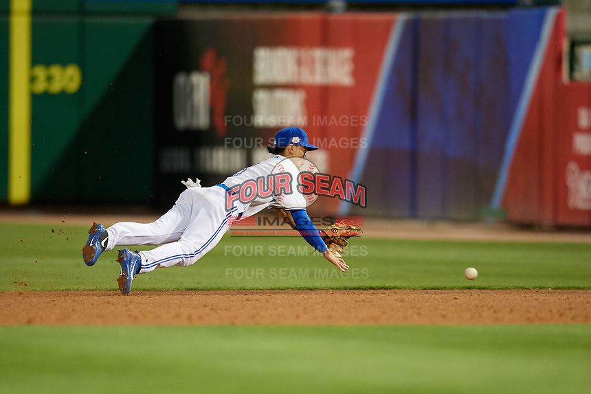 Dunedin Blue Jays second baseman Kevin Vicuna (3) attempts to make a diving stop on a base hit during a Florida State League game against the Clearwater Threshers on April 4, 2019 at Spectrum Field in Clearwater, Florida.  Dunedin defeated Clearwater 11-1.  (Mike Janes/Four Seam Images)