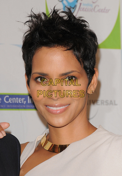 HALLE BERRY.at the Jenesse 30th Anniversary Silver Rose Gala & Auction held at The Beverly Hills Hotel in Beverly Hills, California, USA, April 18th 2010.                                                                   portrait headshot gold collar metal slit cut out white cream beige sleeveless cropped short hair smiling .CAP/RKE/DVS.©DVS/RockinExposures/Capital Pictures.
