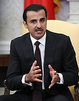 U.S. President Donald Trump speaks during a meeting with the Emir of Qatar Sheikh Tamim bin Hamad Al Thani, in the Oval Office at the White House, on April 10, 2018 in Washington, DC. President Trump has announced that he canceled his upcoming trip to the 8th annual Summit of the Americas in Lima, Peru. <br /> <br /> CAP/MPI/RS<br /> &copy;RS/MPI/Capital Pictures