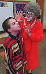 Globe photo Bethany Versoy  story/  Fun Pages.  Braintree Ma.  Barry Lubin , as Grandama from the Big Apple Circus, clowns with  Joe Smith a  5th grader +Fun Page staffer at Braintree Highland Elementary School. RESTRICTED USE.NOT FOR REPBULICATION WITHOUT EXPLICIT APPROVAL FROM DIRECTOR OF PHOTOGRAPHY