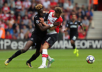 (L-R) Tammy Abraham of Swansea City challenged by Jack Stephens of Southampton during the Premier League match between Southampton and Swansea City at the St Mary's Stadium, Southampton, England, UK. Saturday 12 August 2017