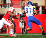 LINCOLN, NE - SEPTEMBER 21, 2013:  David Santos #41 of Nebraska just misses Zach Zenner #31 of South Dakota State during their college football game Saturday at Memorial Stadium in Lincoln, NE.  Zenner scored a touchdown on the play.  (Photo by Dick Carlson/Inertia)