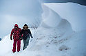 02/03/18<br /> <br /> Hikers, Chlo&eacute; Kirkpatrick and Ben Lester, walk along a road closed by massive snowdrifts in Sparrowpit near Buxton in the Derbyshire Peak District.<br />   <br /> All Rights Reserved F Stop Press Ltd. +44 (0)1335 344240 +44 (0)7765 242650  www.fstoppress.com