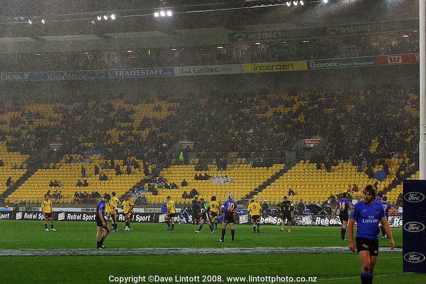 The rain pours down as Piri Weepu prepares to take a conversion attempt. Super 14 match. Hurricanes v Western Force at Westpac Stadium, Wellington. Friday, 9 May 2008. Photo: Dave Lintott / lintottphoto.co.nz