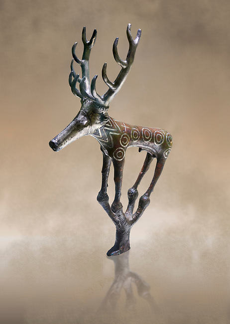 Bronze Age Hattian ceremonial deer statuette in bronze from a possible Bronze Age Royal grave (2500 BC to 2250 BC) - Alacahoyuk - Museum of Anatolian Civilisations, Ankara, Turkey. Against a warm art background